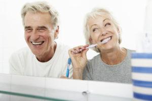 senior couple, brushing, dental routine, dental hygiene