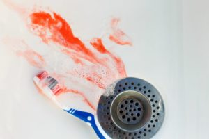 blood in sink beside toothbrush
