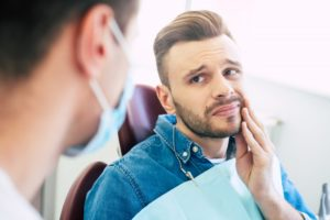 Man with toothache visiting emergency dentist in Ponte Vedra Beach