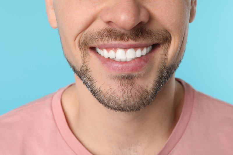 an up-close view of a man's smile that shows his tooth enamel in Ponte Vedra